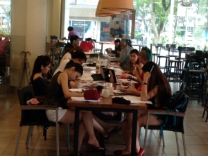 Singaporean students studying at a Starbucks